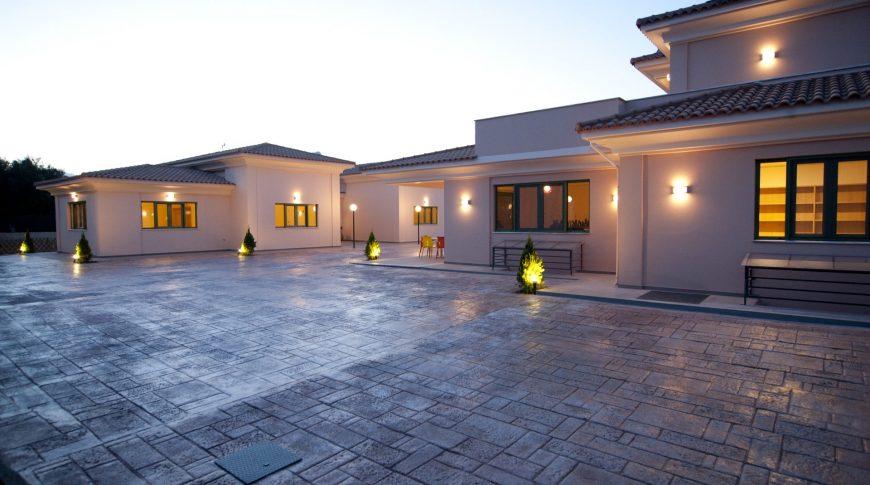 "CONSTRUCTION OF FOUR NEW BUILDINGS AT TEMENI OF EGIO - ""HAMOGELO TOU PAIDIOU"" FOUNDATION"